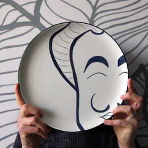 La faccia nel piatto • Salvador Dalì